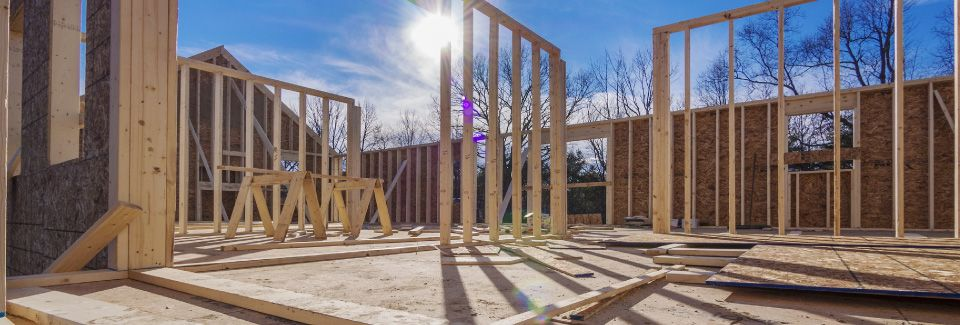 house framing being completed